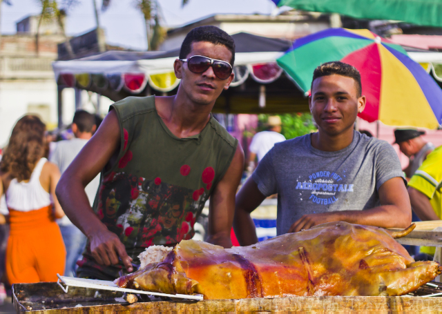Solo travel; Carnival vendor at Camaguey on the Caribbean island of Cuba on Mallory on Travel, adventure, adventure travel, photography Iain Mallory-300-229 camaguey_festival