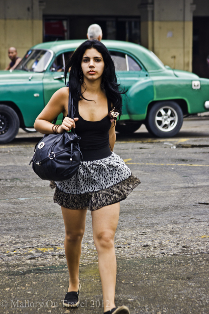 Female traveller in the Cuban capital of Havana on the Caribbean island of Cuba on Mallory on Travel, adventure, adventure travel, photography Iain Mallory-300-26 havana_girl
