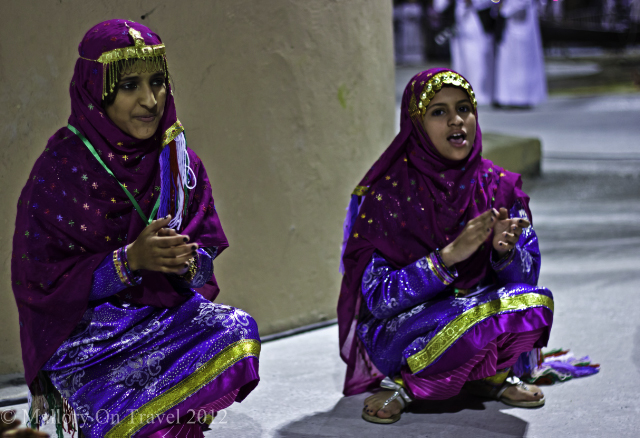 International Women's Day; Young Omani girls in national dress performing at the Muscat Festival on Mallory on Travel, adventure, adventure travel, photography Iain Mallory-300-7 omani_girls