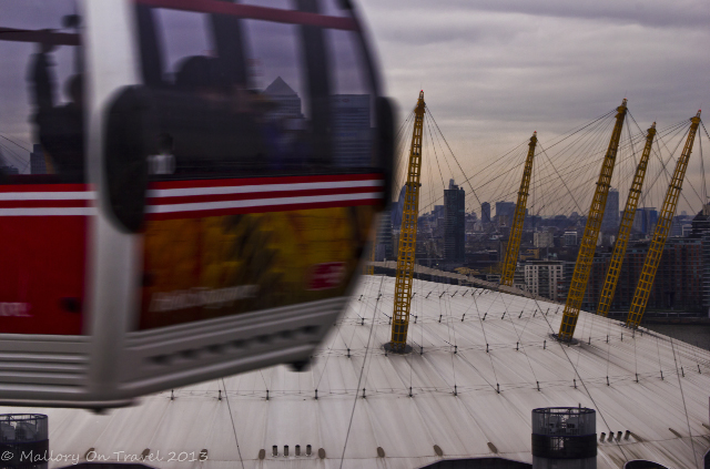 Passing over O2 Arena and the River Thames in London before taking the Emirates Air Line the cable car system which links to the Royal Docks on Mallory on Travel, adventure, adventure travel, photography Iain Mallory-300-80 london