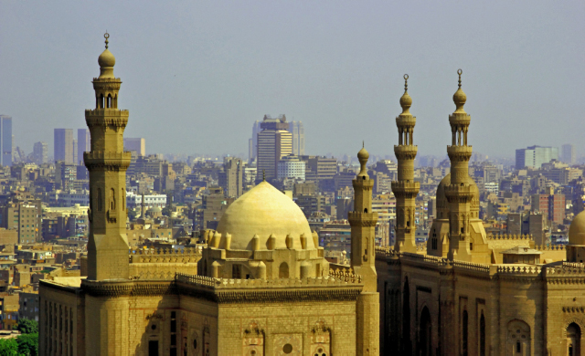 A view of the smog filled sky of Cairo with it's mosques and high rise buildings in Egypt on Mallory on Travel, adventure, adventure travel, photography Cairo_mosque