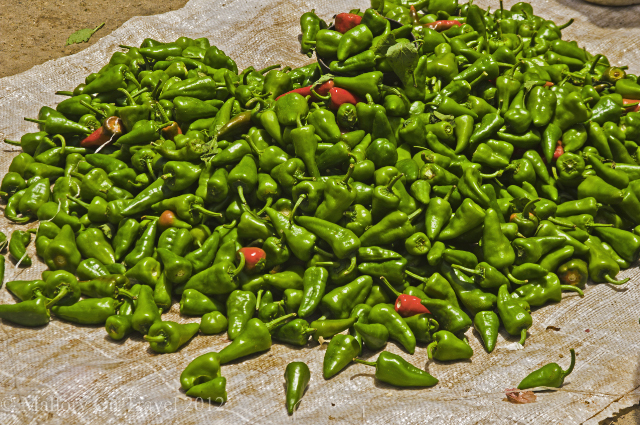 Green chillies in the impromptu market at Baracoa on the Caribbean island of Cuba on Mallory on Travel, adventure, adventure travel, photography Iain Mallory-300-75 green_chillies