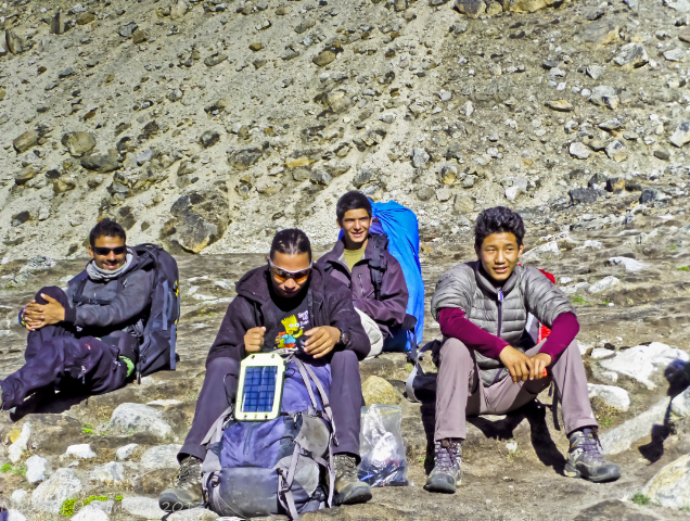 Travel gear; Sherpa porters on the Everest Base Camp trek in Nepal, the Himalaya Sherpa porters in the shadow of Pumori in the high Himalaya, Nepal