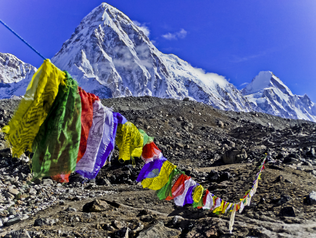 Trekking in Nepal; Tibetan prayer flags in the Himalaya mountains of Khumbu on Mallory on Travel, adventure, adventure travel, photography