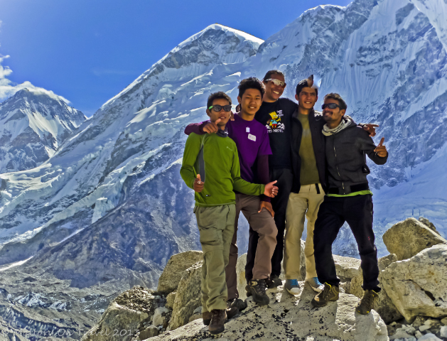 Trekking in Nepal; Sherpa guides standing in front of Everest in the Himalayan Khumbu region on Mallory on Travel, adventure, adventure travel, photography
