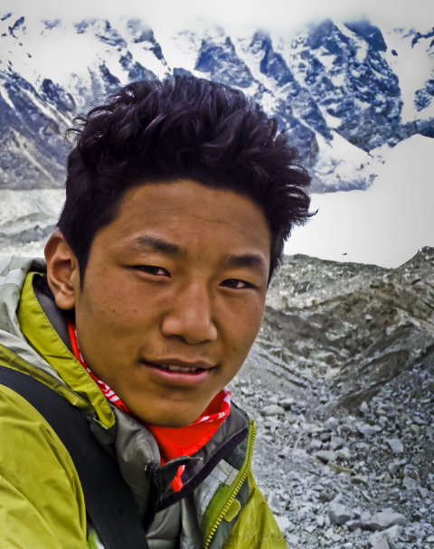 Treks to Nepal; A young Sherpa porter with a commercial trek to Everest Base Camp in the Himalaya on Mallory on Travel, adventure, adventure travel, photography