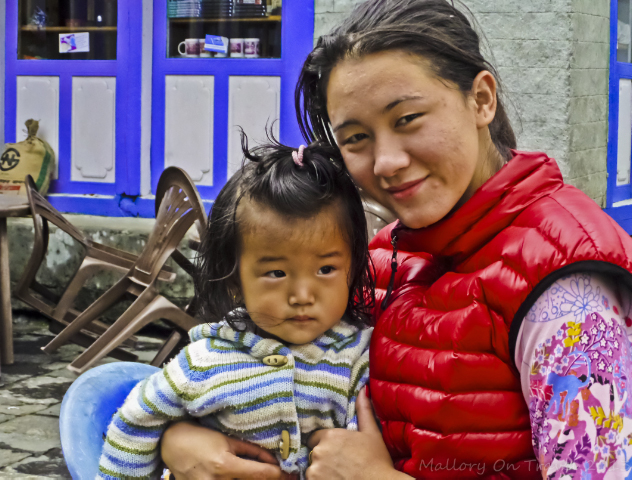 Mother and child in Nepal in Phanding in the Khumbu region on the Everest base camp route on Mallory on Travel, adventure, adventure travel, photography
