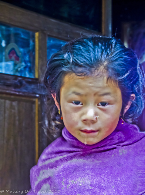 Young girl in Lukla, Nepal in Phanding in the Khumbu region on the Everest base camp route on Mallory on Travel, adventure, adventure travel, photography