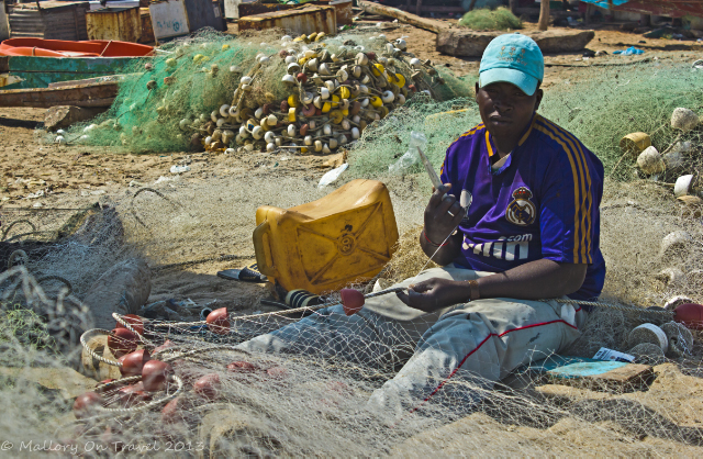 Fisherman repairing his nets on the beach at Tanji market, The Gambia, West Africa on Mallory on Travel, adventure, photography and travel Iain Mallory-300-43 fisherman_gambia