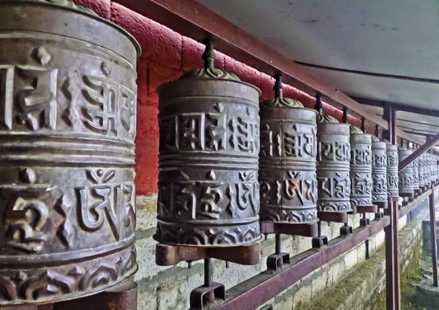 Trekking in Nepal; Prayer wheels at the Tengeboche Monastery in the Khumbu region of the Nepali Himalaya on Mallory on Travel, adventure, adventure travel, photography