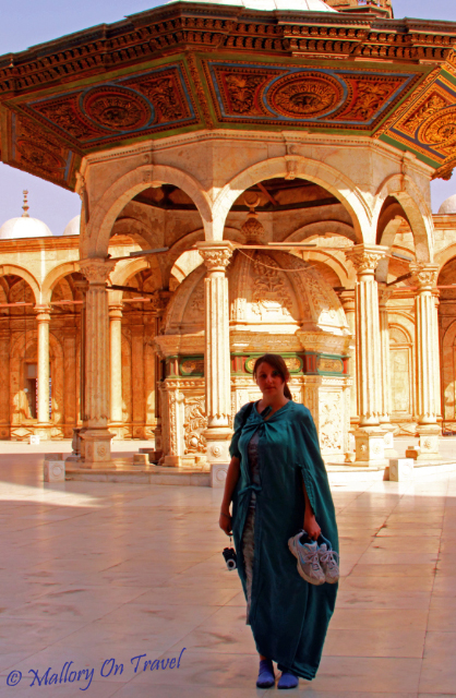 Travel gear; Tourist at the Muhammad Ali Mosque in Cairo, Egypt on Mallory on Travel, adventure, adventure travel, photography