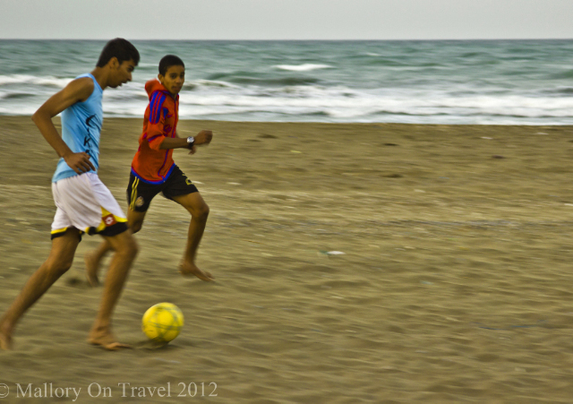 Football stars of the future playing on the beach in Seeb, near Muscat, Oman on Mallory on Travel adventure, adventure travel, photography Iain Mallory -170-1