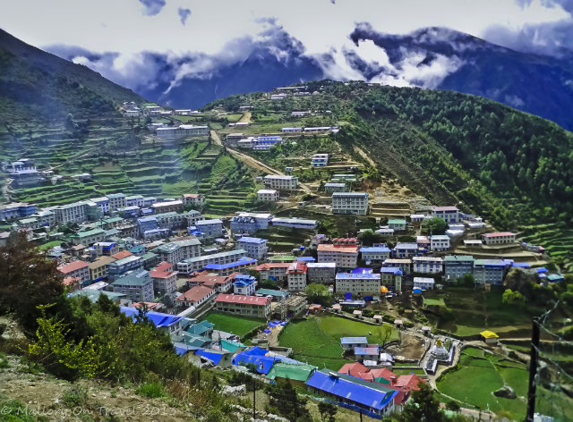 Looking down on Namche Bazaar on the Mount Everest base camp in the Khumbu region of Nepal, in the Himalaya adventure, adventure travel, photography on Mallory on Travel