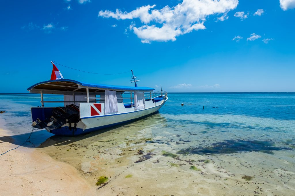 Freedom; A tourist boat at Pulau Hoga in Wakatobi in the Republic of Indonesia on Mallory on Travel adventure, adventure travel, photography