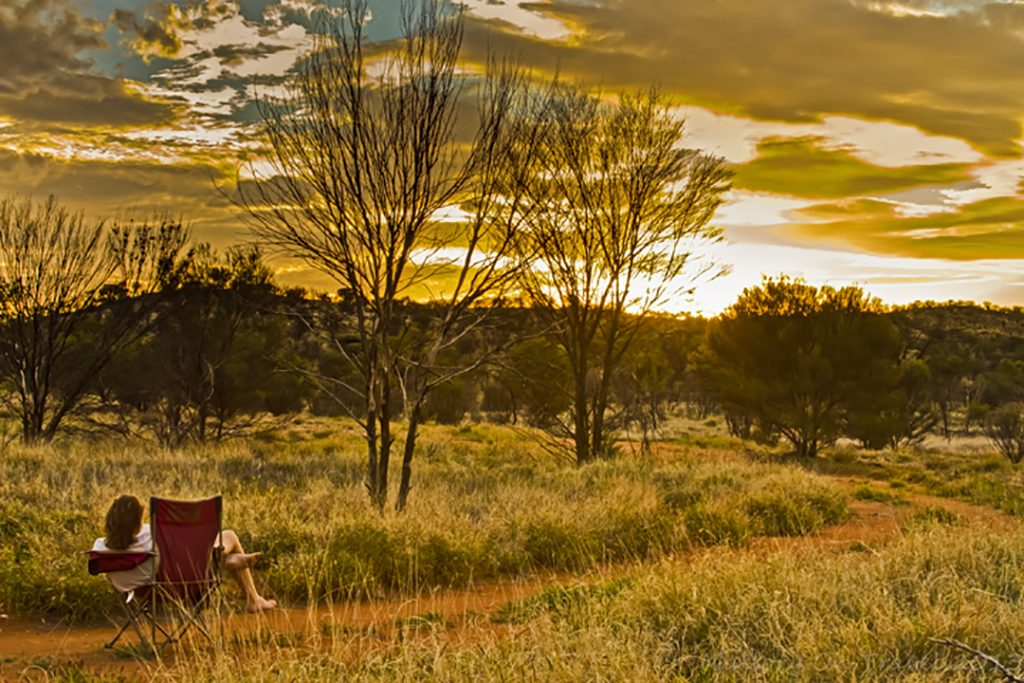 Bookreading at sunset on the Larapinta Trail in the west MacDonnell Ranges in the Northern Territory, Australia on Mallory on Travel adventure, adventure travel, photography Iain Mallory-300-97_larapinta