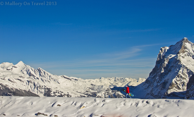 A freerider going off piste under the Eiger, in the Jungfrau region, of the Bernese Alps, Switzerland on Mallory on Travel adventure, adventure travel, photography Iain Mallory-300-16 jungfrau_region