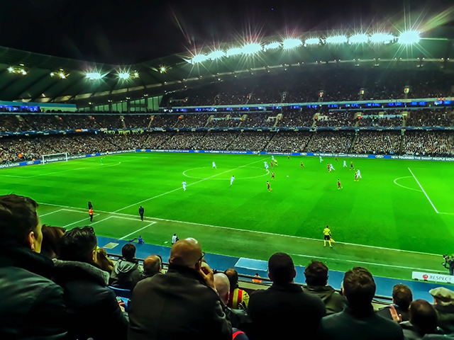 Football supporters at the impressive Etihad Stadium for Manchester City vesus FC Barcelona on Mallory on Travel adventure, adventure travel, photography