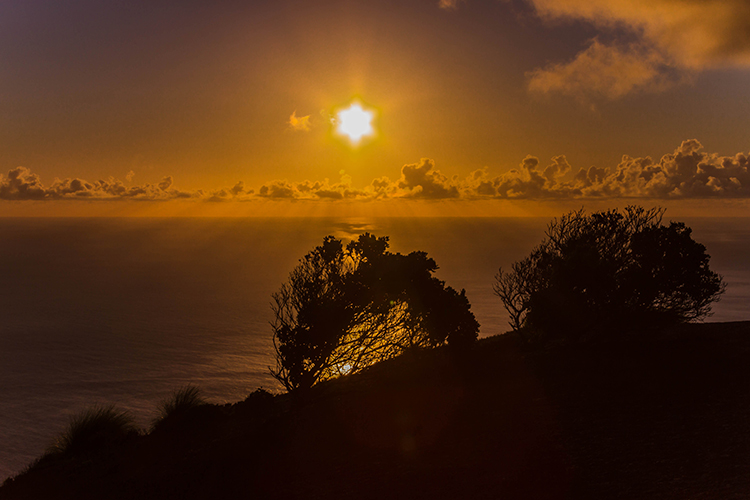 Sunset silhouettes ilsand of St Helena in the South Atlantic on Mallory on Travel adventure, adventure travel, photography Iain Mallory-101 south_atlantic