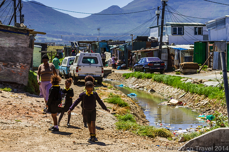Schoolchildren returning home in the township of Masiphumelele near Cape Town, South Africa on Mallory on Travel adventure, adventure travel, photography Iain Mallory-300-101 masiphumelele_schoolchildren