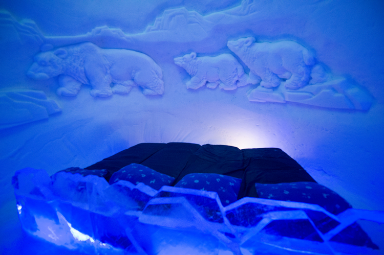 Ice bed and wall carving Kirkenes snow hotel in Hurtigruten, Arctic Norway on Mallory on Travel adventure, adventure travel, photography s