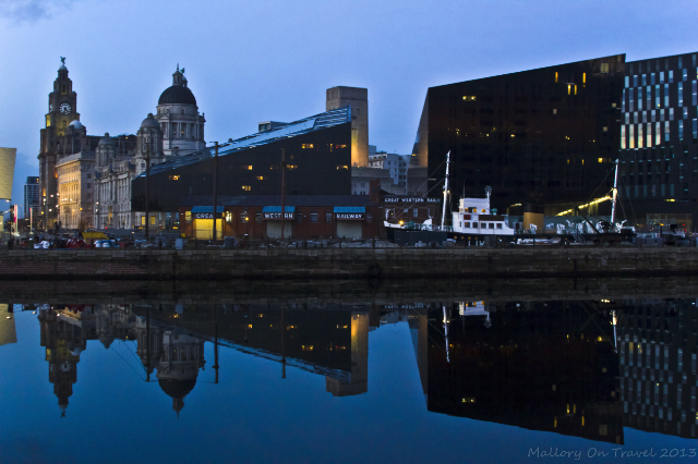 A reflection of the Liver Builiding in the Albert Dock in Liverpool on Mallory on Travel, adventure, adventure travel, photography