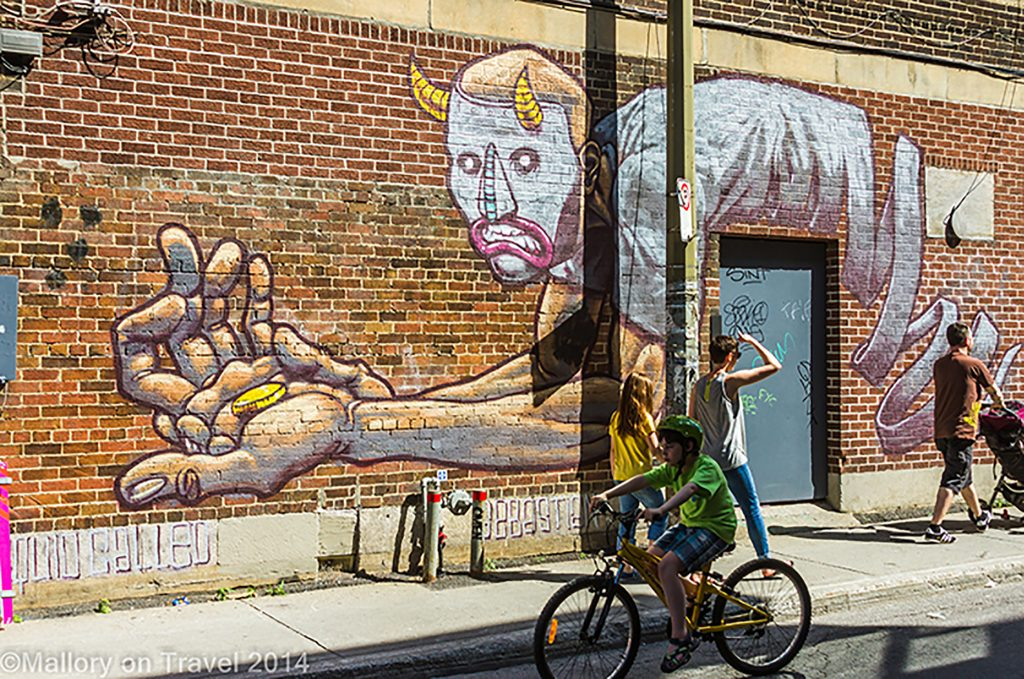 People at the Montreal mural festival of street art, the creative streets of the Quebec province city, Canada on Mallory on Travel adventure, adventure travel, photography Iain Mallory-300-87 montreal_streetart