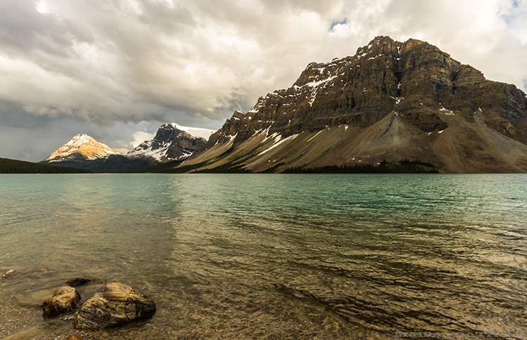 Sunlit rocks in Bow Lake near Lake Louise, Alberta, Canada on Mallory on Travel adventure, adventure travel, photography Iain_Mallory-323 bow_lake