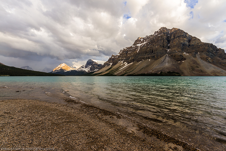 Lapping waves on the shore of Bow Lake near Lake Louise, Alberta, Canada on Mallory on Travel adventure, adventure travel, photography Iain_Mallory-324 bow_lake