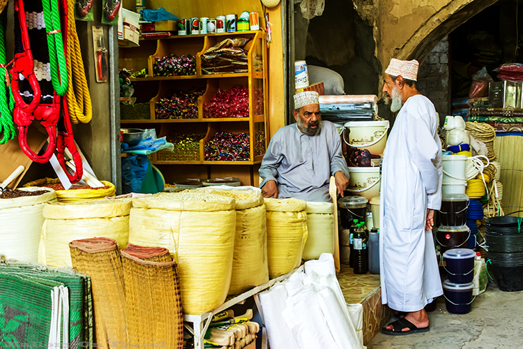Stall holders in the Nizwa souk in the Sultanate of Oman on Mallory on Travel adventure, adventure travel, photography Iain Mallory-101 nizwa_souk