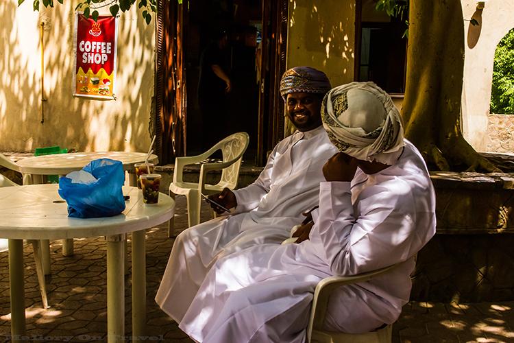 Omani men enjoying coffee in Nizwa, the Sultanate of Oman on Mallory on Travel adventure, adventure travel, photography Iain Mallory-153 omani_men