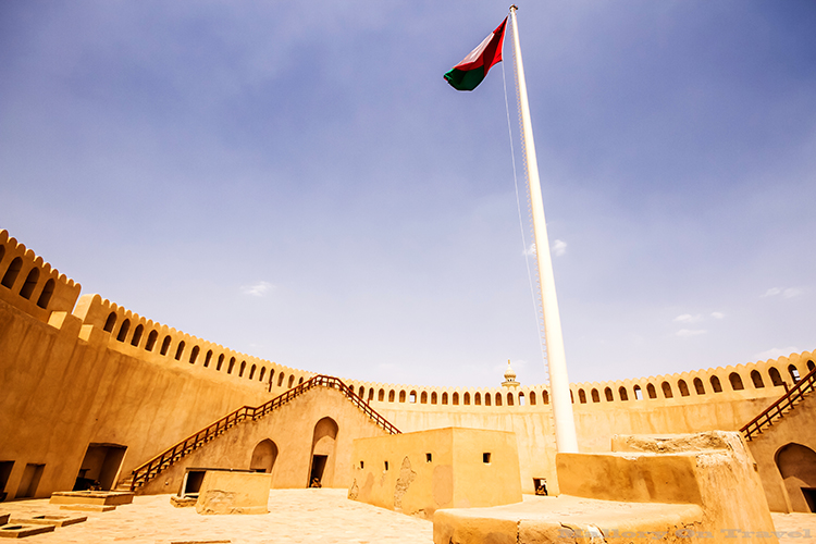 The flag flying in the fort at Nizwa, the Sultanate of Oman on Mallory on Travel adventure, adventure travel, photography Iain Mallory-252 nizwa_fort
