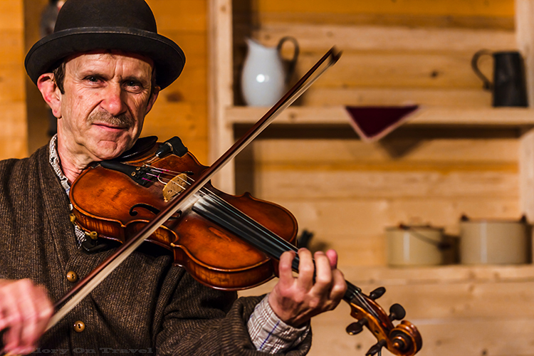 Performer at the Acadian historical village near Caraquet , New Brunswick, Canada on Mallory on Travel adventure, adventure travel, photography Iain Mallory-49 acadian_fiddler