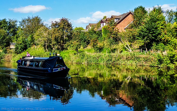 Narrow boats are regular traffic on the Macclesfield canal in Cheshire, England on Mallory on Travel adventure, adventure travel, photography