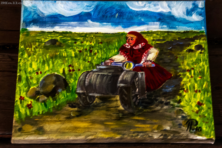 Painting of motorbike riding Kihnu woman in the Baltic State of Estonia on Mallory on Travel adventure, adventure travel, photography Iain_Mallory_Est1402584 kihnu_painting