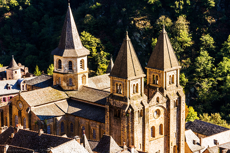 Saint Foy Abbey, Conques near Villefranche de Rouergue on the Saint-Jacques-de-Composte, or Santiago de Compostela and trekkers on the Via Podiensis, GR 65 in the Aveyron region of the South of France on Mallory on Travel adventure, adventure travel, photography Iain_Mallory_Ave1403453 conques