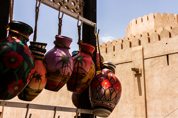 Visual storytelling; Colourful pottery in the souk at Nizwa, in the Sultanate of Oman on Mallory on Travel adventure, adventure travel, photography Iain Mallory-CR1405408 nizwa_oman
