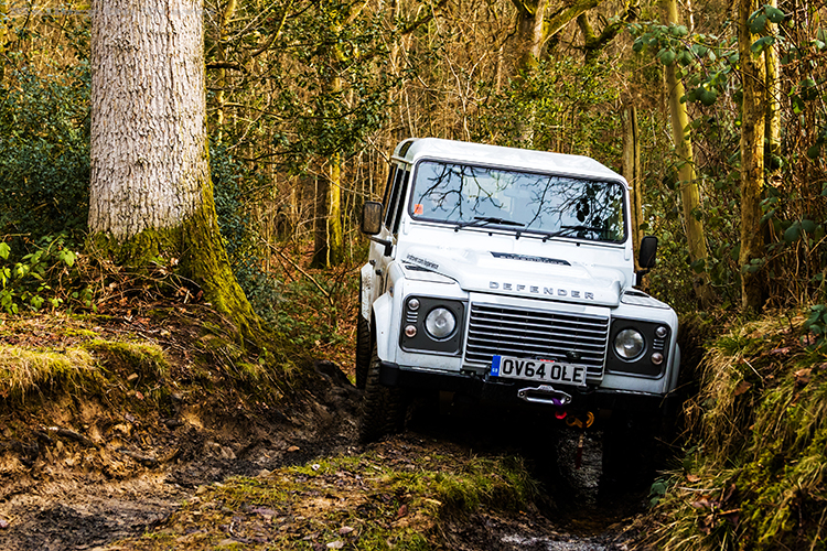 Driving and hard banking a Landrover Defender 110 on a LandRover Experience Day at Eastnor Castle near Ledbury in the Malvern Hills on Mallory on Travel adventure, adventure travel, photography Iain_Mallory_LR1407839 landrover_defender