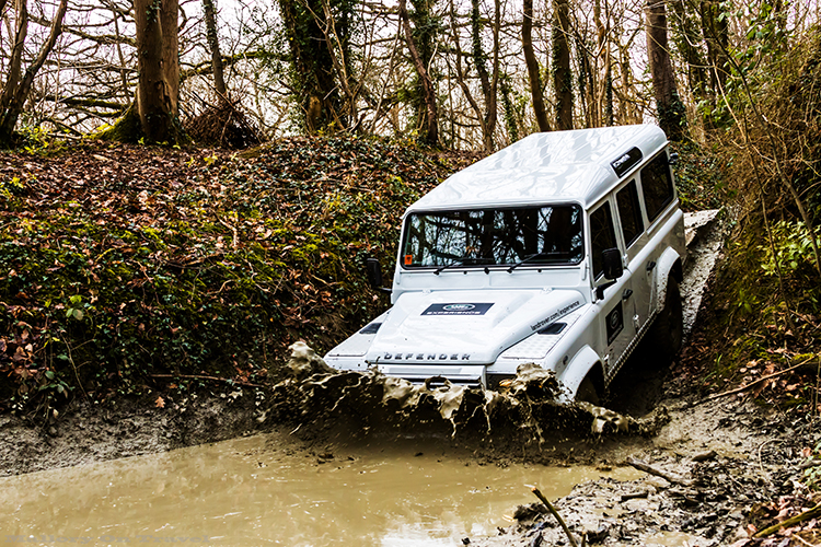 Driving a Landrover Defender 110 into a dyke on a LandRover Experience Day at Eastnor Castle near Ledbury in the Malvern Hills on Mallory on Travel adventure, adventure travel, photography Iain_Mallory_LR1407926