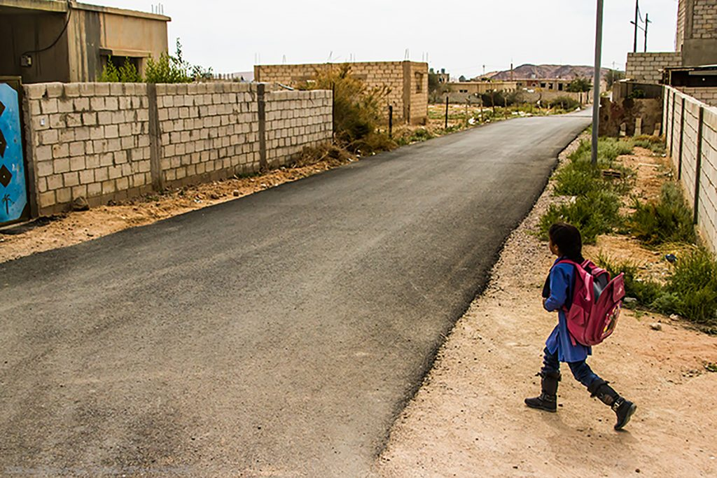 A schoolchild heading home in a small village in Jordan, near Feynan Ecolodge on Mallory on Travel adventure, adventure travel, photography Iain_Mallory_Jordan1408551