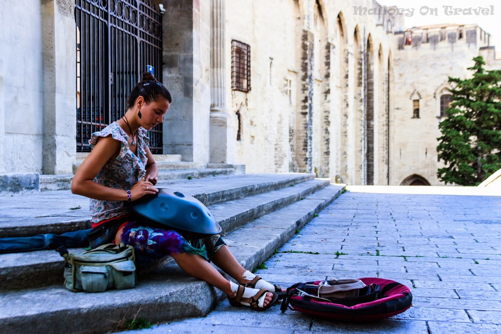 Budget travel - Rhône Valley: Street performer on the steps of the Papal Palace in Avignon, Provence in the South of France on Mallory on Travel adventure, adventure travel, photography Iain_Mallory_Rhone1412224