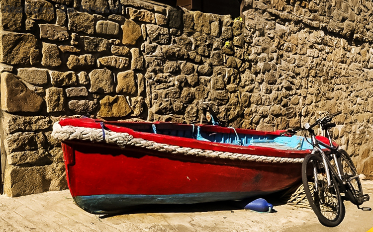 A small rowing boat just off the high street of Hugh Town, St Mary's in the Scilly Isles on Mallory on Travel adventure travel, photography, travel Scilly Isles-155