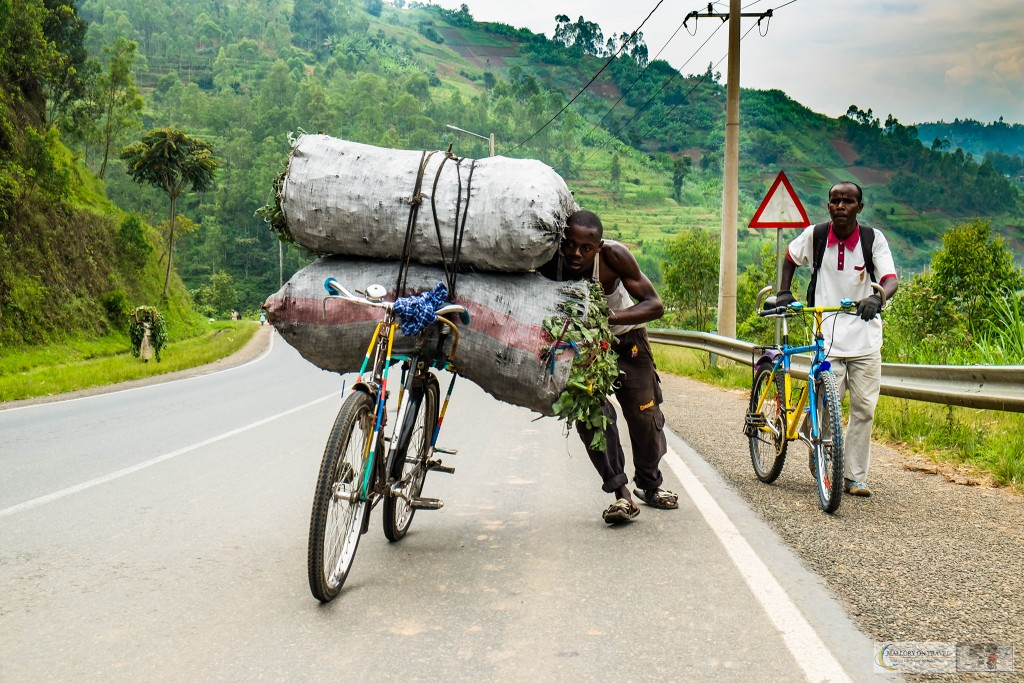 Transporting heavy loads on a bicycle on the road to Kigali, Rwanda in east Africa on Mallory on Travel adventure travel, photography, travel Iain_Mallory_Rwanda-1903