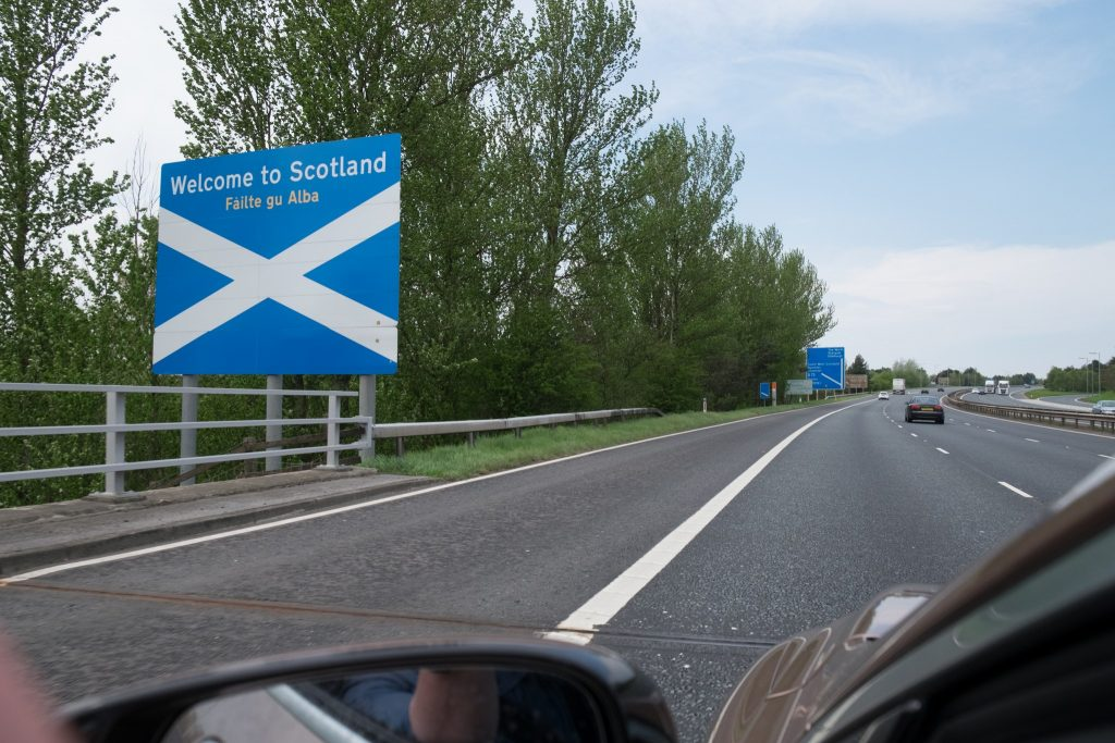 The border crossing sign entering Scotland, on a highlands and islands road trip Iain Mallory_ScottishBorder3415