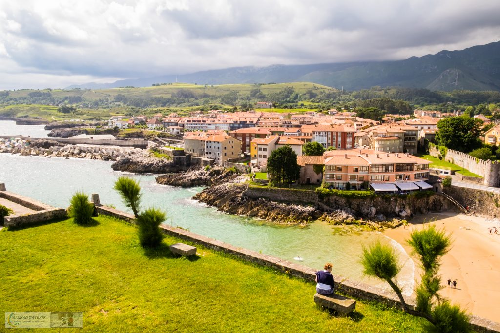 Taking time out from cycling in Asturias to enjoy the view of El Sablón Beach, Llanes on the Camino de Santiago (north) or St James Way in northern Spain on Mallory on Travel adventure travel, photography, travel Iain Mallory_Asturias-1-3