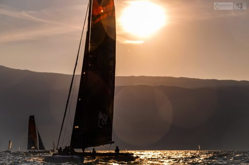 Early light on a racer in the Centomiglia regatta on Lake Garda in the Lombardia region of northern Italy on Mallory on Travel adventure travel, photography, travel iain-mallory_garda-1-61