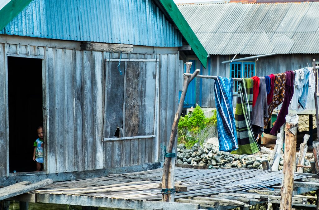 A shy Bajo child in the village in Pulau Hoga, Wakatobi in Indonesia on Mallory on Travel adventure travel, photography, travel iain-mallory_indo-1-69