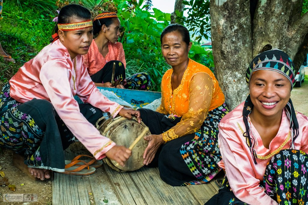Culture of Indonesia; Manggaraian women and musicians in the village of Melo, Flores in the Komodo Island National Park in the Republic of Indonesia on Mallory on Travel adventure travel, photography, travel iain-mallory_indo-1-19