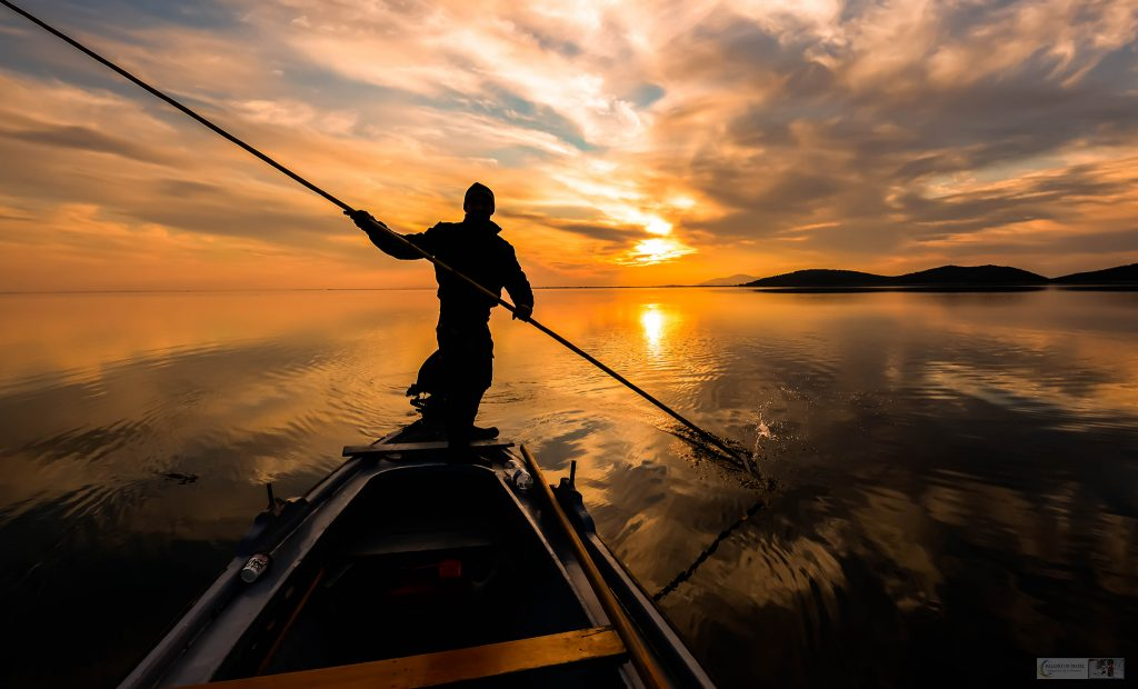 Favourite photos; A lone fisherman poles his boat in the shallow Messolonghi Lagoon, western Greece on Mallory on Travel adventure travel, photography, travel Iain Mallory Greece_8384-163