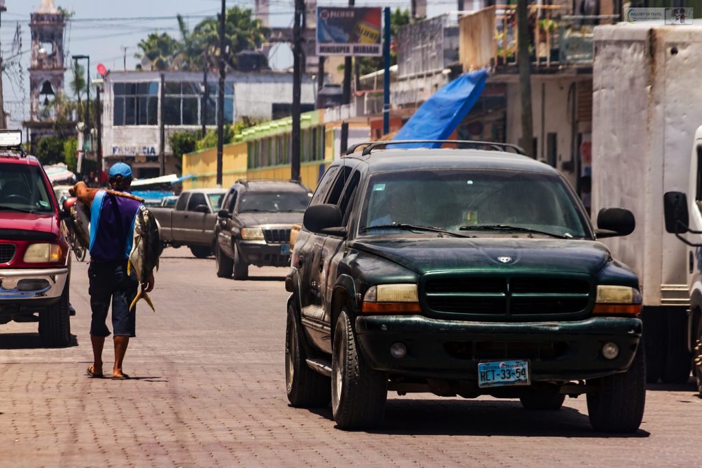A fisherman with his catch wandering the streets of San Blas on the Riviera Nayarit on the Mexican Pacific coast on Mallory on Travel adventure travel, photography, travel Iain Mallory_Mex 001-72
