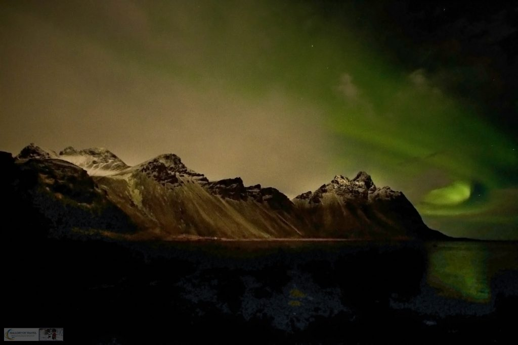 Favourite photos; The aurora borealis or northern lights over the Vesturhorn mountains in the eastern fjords of Iceland on Mallory on Travel adventure travel, photography, travel Iain_Mallory_ICE1407513